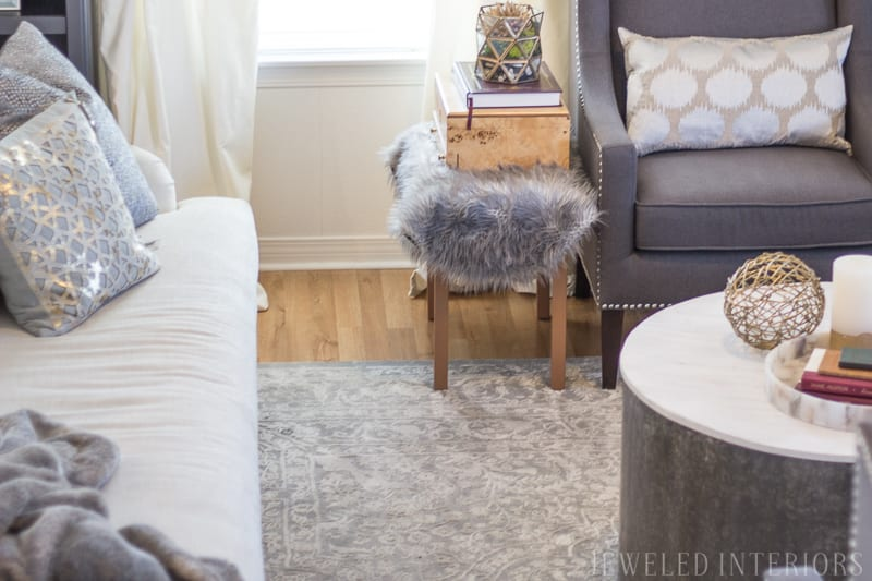 Modern, traditional, glam, eclectic, classy, beautiful, stunning, living room, pottery barn, carlisle, sofa, bench seat, linen, velvet, curtains, pillow, gold, fringe, bookcase, style, living room, rug, interior design, rental home, military housing, roman bust, madison park, weston, wing back, chair, round coffee table