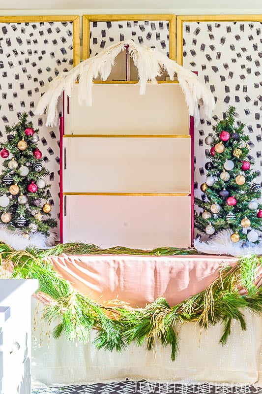 How did she make that DIY Dalmatian Print wallpaper?  It's easy!  || Jeweledinteriors, Dalmatian, diy, wallpaper, preppy, blush, peach, Burgundy, buffet, table, party, Christmas, holiday, ideas, black, white, gold, tutorial, step by step, inexpensive, paintable, wallpaper, wall paper, foam brush, backdrop,