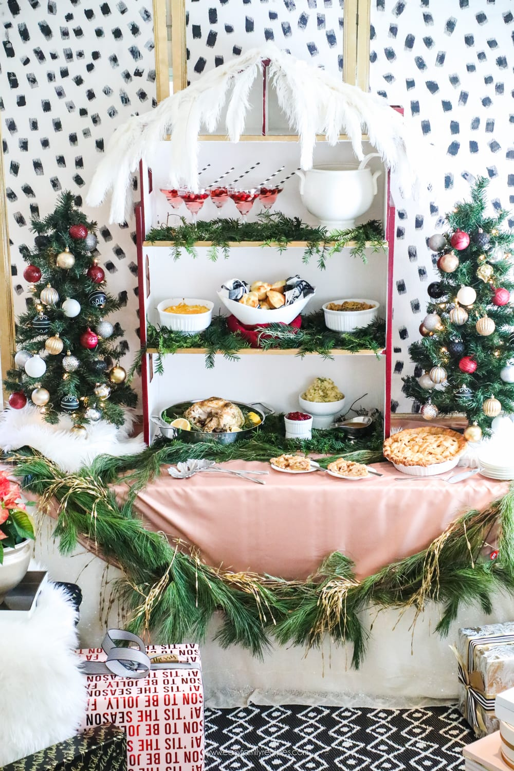 Holiday Party Buffet Table.  It's a barbie house! Looking for inspiration for Christmas Tree inspiration?  You have got to see this || Jeweled Interiors, Holiday, Home Tour, Burgundy, wine, Blush, Christmas, Decor, decoration, Ideas, Tips,  Christmas, holiday, tree,  pink, DIY, inspiration, red, maroon, ostrich feathers, poinsettia, glam, chic, peach, gold, black, white