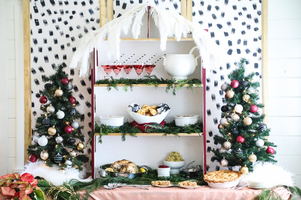 How did she make that DIY Dalmatian Print wallpaper?  It's easy!  || Jeweledinteriors, Dalmatian, diy, wallpaper, preppy, blush, peach, Burgundy, buffet, table, party, Christmas, holiday, ideas, black, white, gold, tutorial, step by step, inexpensive, paintable, wallpaper, wall paper