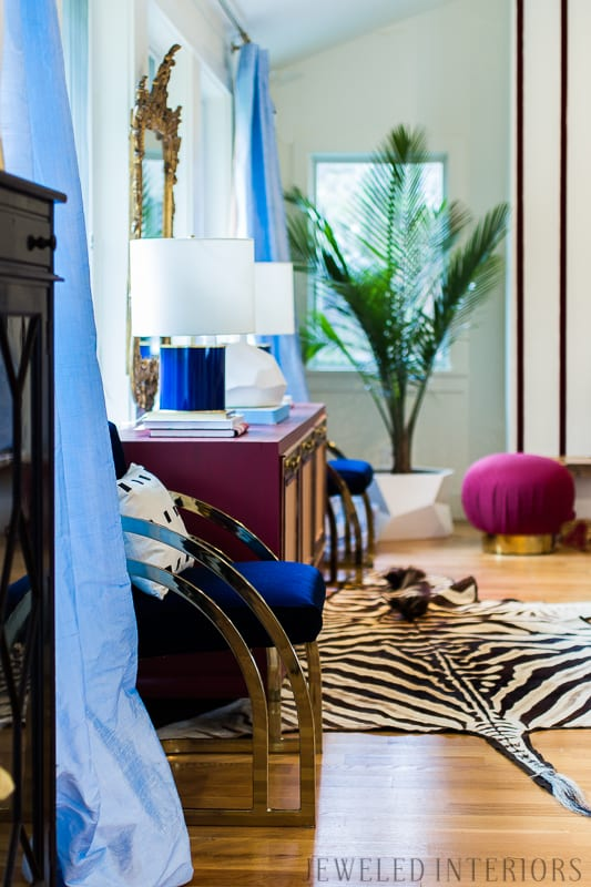 You've got to see this One Room Challenge Make-overs || Jeweledinteriors, antique mirror, One Room Challenge, ORC, parisian, apartment, rental, diy, zebra, rug, hide, milo baughman, navy, velvet, silk, curtains, brass, gold, chic, hardwood floors, antique, mirror, eclectic, kelly wearstler, pillow, kate spade, lamp, powder blue, obelisk, victorian, 1980's, vintage, living room, chic, roman bust, statue
