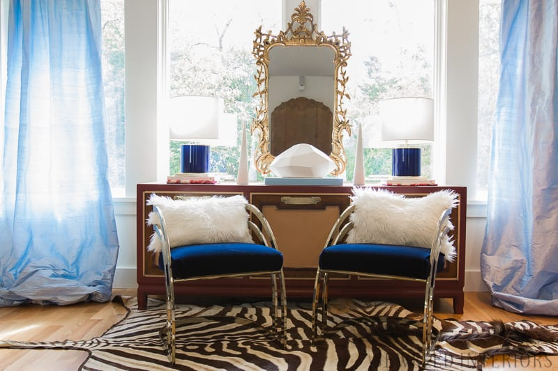 You've got to see this One Room Challenge Make-overs || Jeweledinteriors, One Room Challenge, ORC, parisian, apartment, rental, diy, zebra, rug, hide, milo baughman, navy, velvet, silk, curtains, brass, gold, chic, hardwood floors, antique, mirror, eclectic, kelly wearstler, pillow, kate spade, lamp, powder blue, obelisk, victorian, 1980's, vintage, living room, chic, roman bust, statue