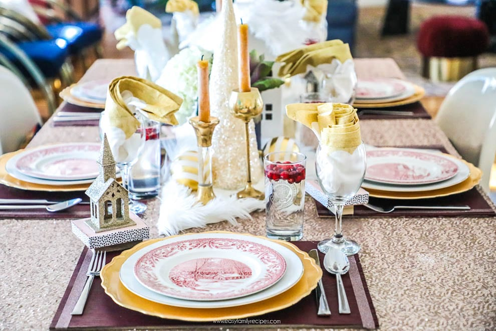 I learned so much from this 8 step tutorial on how to set a pretty tablescape! || Jeweledinteriors, jeweled interiors, party, planning, dinner, brunch, banquet, table, setting, centerpiece, placemats, napkin, pomegranate, feather, gold, salad, charger, placemat, rings, flowers, candles, vintage, dollar store, beautiful, sequin, sheepskin, texture