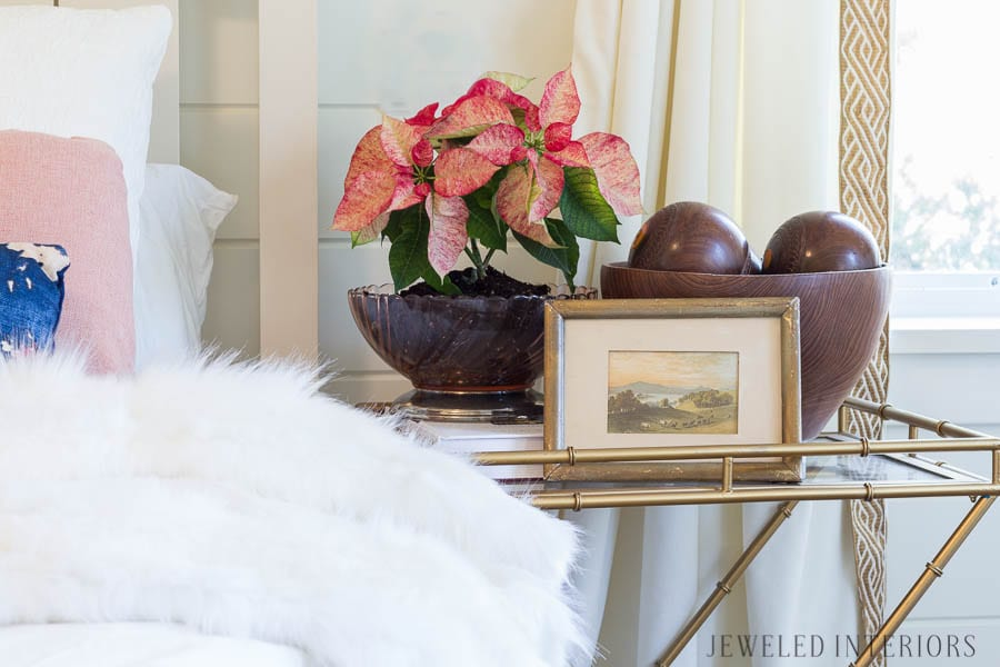 JUST A TOUCH OF CHRISTMAS IN THE BEDROOM. A white bedroom with pops of color: Looking for inspiration for a eclectic, chic, an glam Christmas? You have got to see this! Jeweled Interiors, Holiday, Home Tour, Burgundy, cranberry, blush, Christmas, Decor, Ideas, Tips, wreaths, Christmas, tree, decor, decorations, DIY, inspiration, red, maroon, wine, home tour, poinsettia, glam, chic, peach, gold, black, white