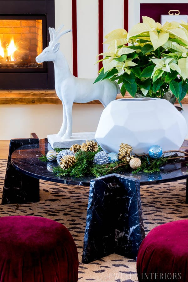 HOLIDAY COFFEE TABLE DECOR || Looking for inspiration for an eclectic, chic, and glam Christmas? Jeweled Interiors, Holiday, Home Tour, Burgundy, cranberry, blush, Decor, Ideas, Tips, black, marble, Christmas, tree, decor, decorations, DIY, inspiration, red, maroon, wine, home tour, poinsettia, glam, chic, peach, gold, black, white, statue, reindeer
