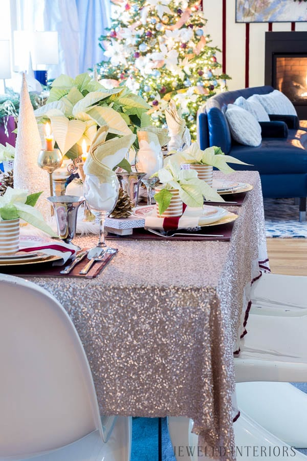 THIS DINING ROOM! Looking for inspiration for an eclectic, chic, and glam Christmas? Jeweled Interiors, Holiday, Home Tour, Burgundy, cranberry, blush, Decor, Ideas, Tips, wreaths, Christmas, tree, decor, decorations, DIY, inspiration, red, maroon, wine, home tour, poinsettia, glam, chic, peach, gold, black, white, Panton, chairs, brass, chandelier, tablescape,