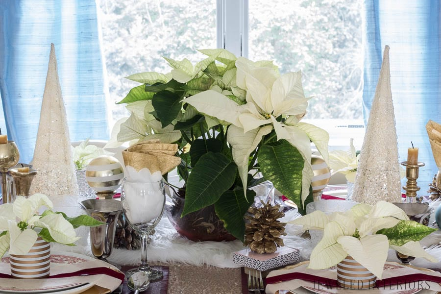 I learned so much from this 8 step tutorial on how to set a pretty tablescape!    Jeweledinteriors, jeweled interiors, party, planning, dinner, brunch, banquet, table, setting, centerpiece, placemats, napkin, pomegranate, feather, gold, salad, charger, placemat, rings, flowers, candles, vintage, dollar store, beautiful, sequin, sheepskin, texture
