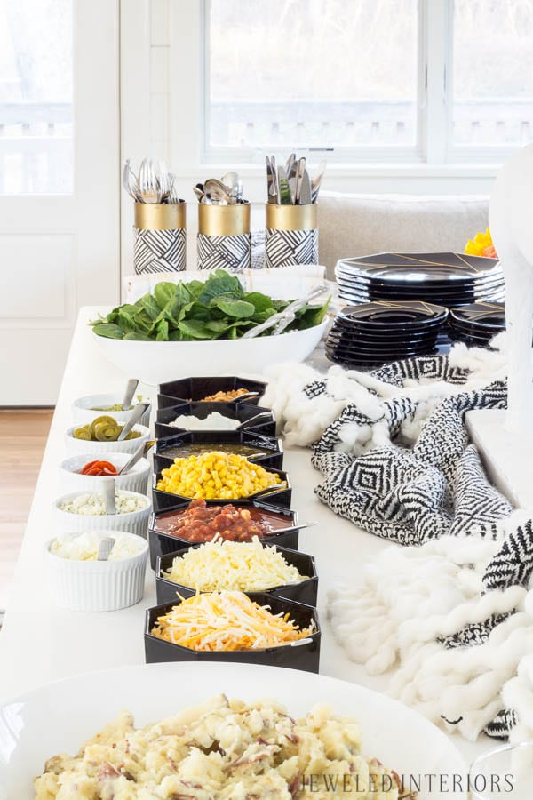 Apres Ski Party Blog Hop|| Jeweled Interiors, party, ski, buffet, tablescape, table, setting, black and white, candles, brass, potato bar, mashed potato, china, vintage, brass, candle stick, buffet line, simple, easy, lunch, dinner, brunch, buffet, flowers