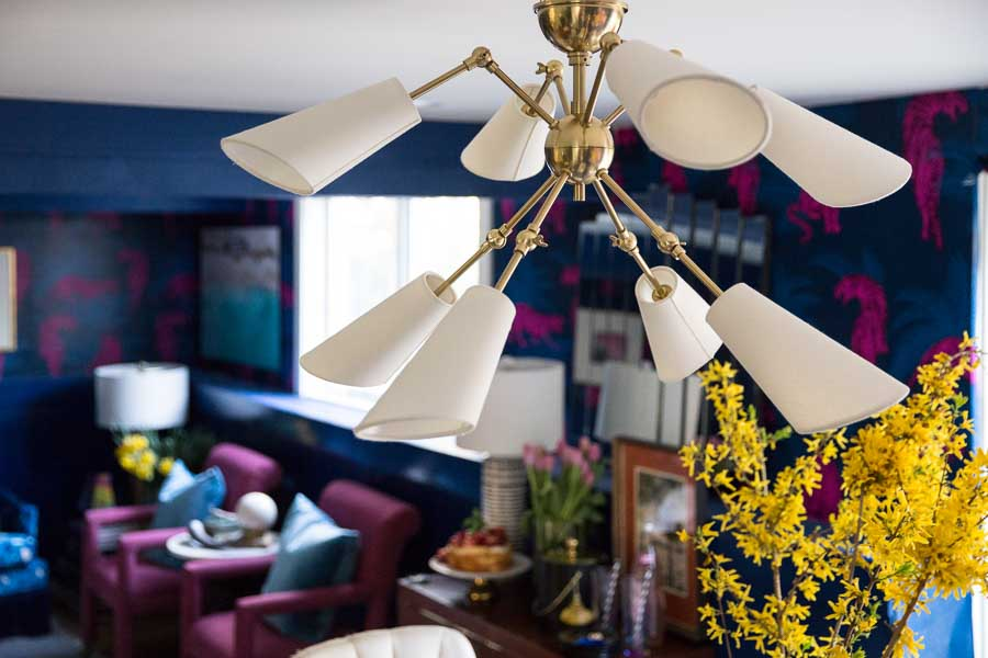 This Buckingham Chandelier Hudson Valley Lighting from Lamps plus is incredible! I love the way is mixes with this bold and eclectic room