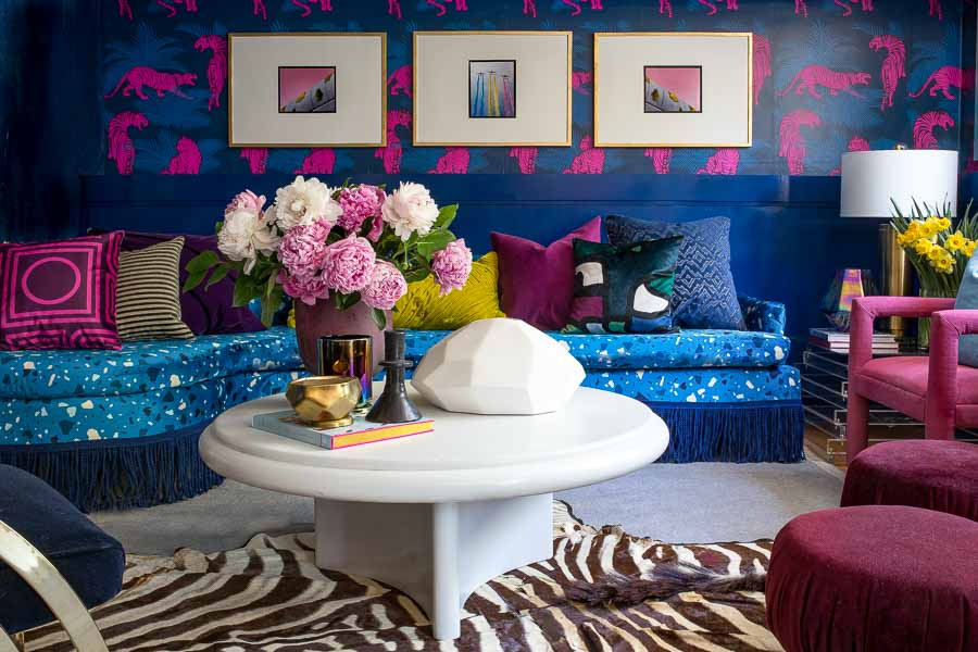 Check out this amazing Terrazzo, blue, velvet, sofa with custom fabric from Spoonflower. I can't believe those chairs were painted. I Love the Tiger wallpaper too.