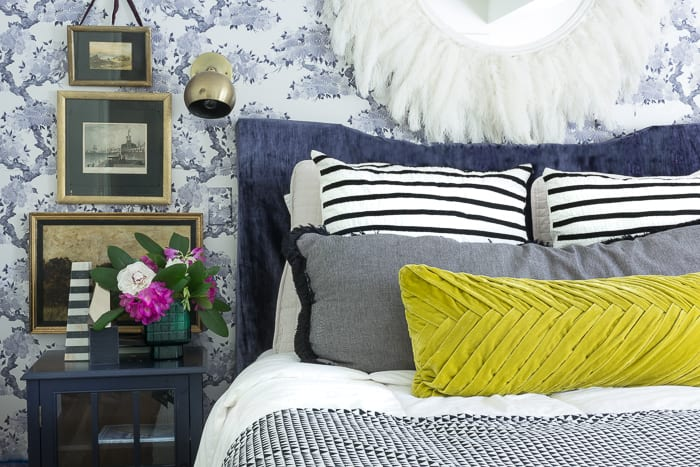 Kimono Wallpaper makes for a stunning chinoiserie bedroom with vibrant accents of mustard yellow and purple.