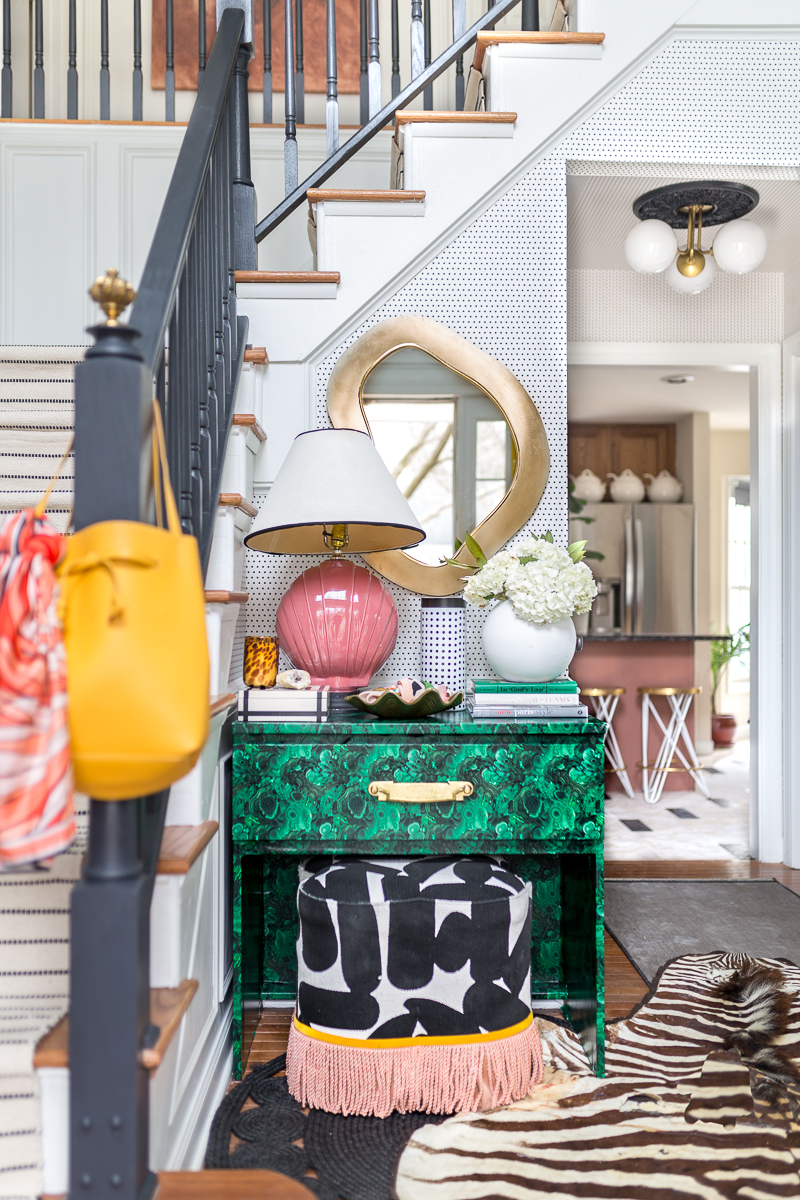 Check out this colorful and eclectic entryway, entryway, milton and king, simplimente puntos, wallpaper, mitzi lighting, foyer, art deco, eclectic, fringe, ottoman, malachite, contemporary, black handrails, diy stair runner, m