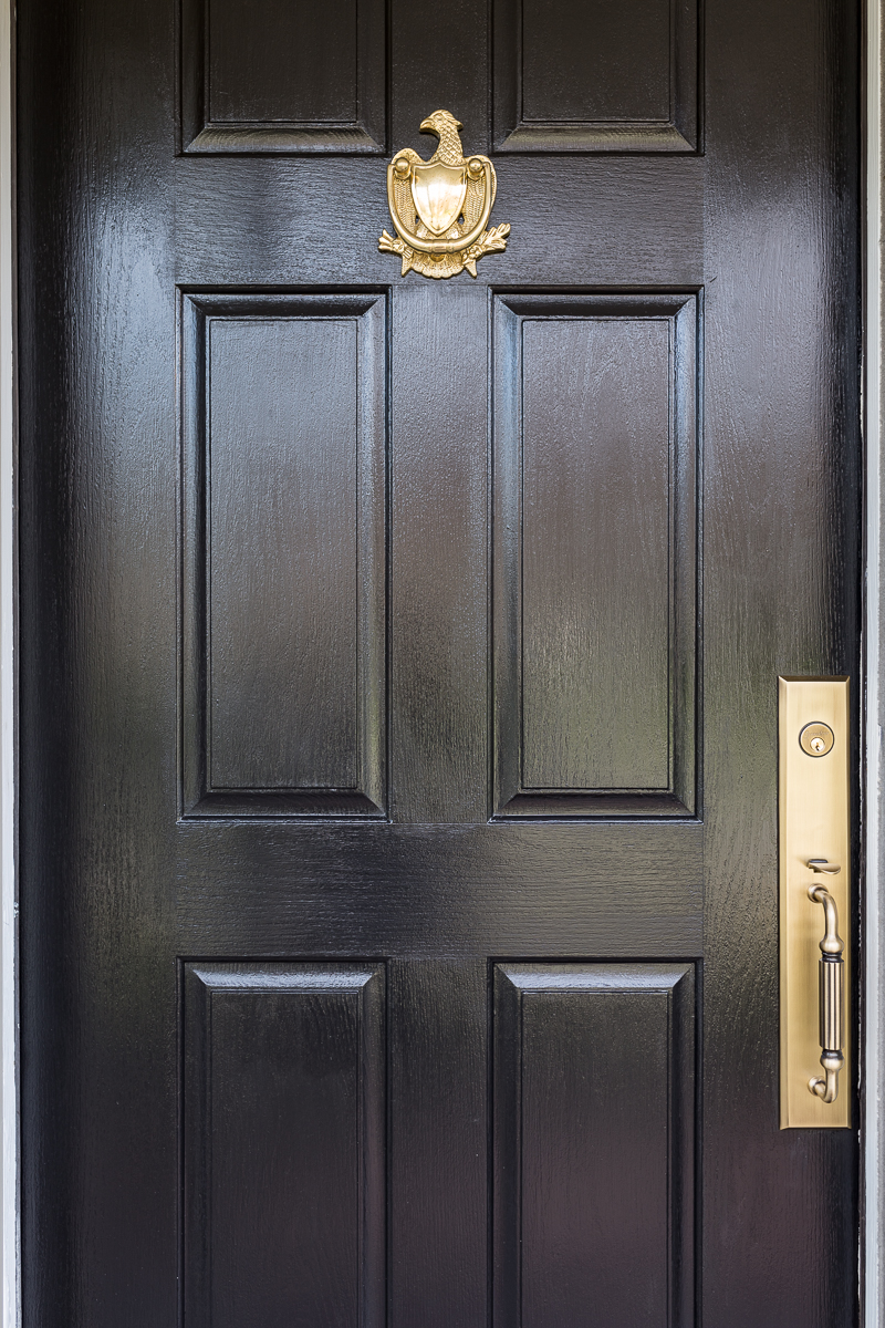 check out this black front door with brass hardware, federalist eagle knocker, vintage knocker, brass knocker, colonial knocker, grandeur hardware, jewel marlowe, jeweled interiorsors,