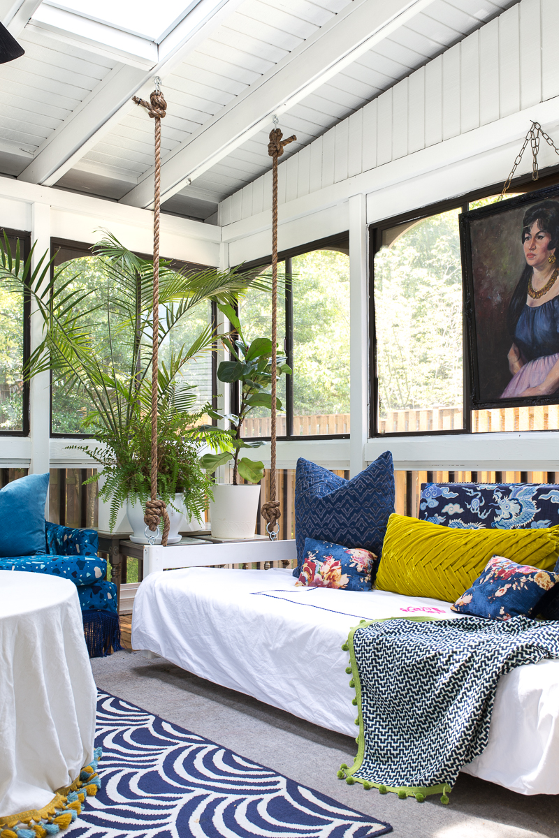 sunroom big reveal, maximalist room, maximalist sofa, maximalist sunroom, blue sofa, sofa with fringe, fringed sofa, terrazzo sofa, jeweled interiors, budget make over, budget sunroom makeover,  bed swing, twin bed swing, sunroom bed swing, bohemian sunroom, colorful sunroom, Jeweledinteriors, DIYs