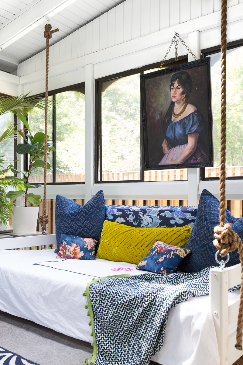 You've got to see this! sunroom big reveal, maximalist room, maximalist sofa, maximalist sunroom, blue sofa, sofa with fringe, fringed sofa, terrazzo sofa, jeweled interiors, budget make over, budget sunroom makeover,  bed swing, twin bed swing, sunroom bed swing, bohemian sunroom, colorful sunroom, Jeweledinteriors, DIYs