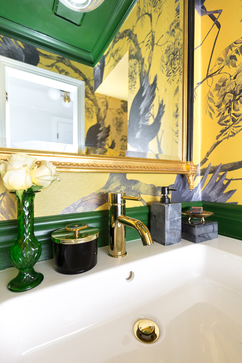 You've got to see the rest of this bathroom! I love this brass faucet in our powder room.  Designed by Jeweled Interiors