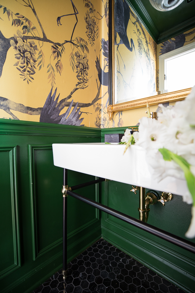 I'm so in love with this dramatic powder room.  The powder room console sink and chinoiserie wallpaper are divine