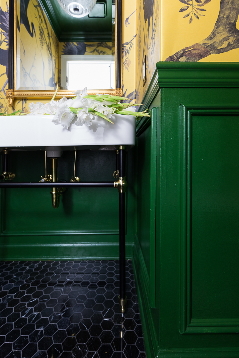 You've got to see the rest of this bathroom.  Yellow and green powder room with moulding and chair rail