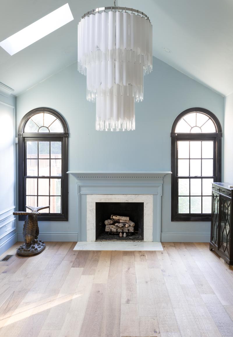 leopard chairs on lifecor flooring, Anton Fresh Aire, life core engineered hardwoods, blue walls, black trim, oversized chandelier, hardwood floors