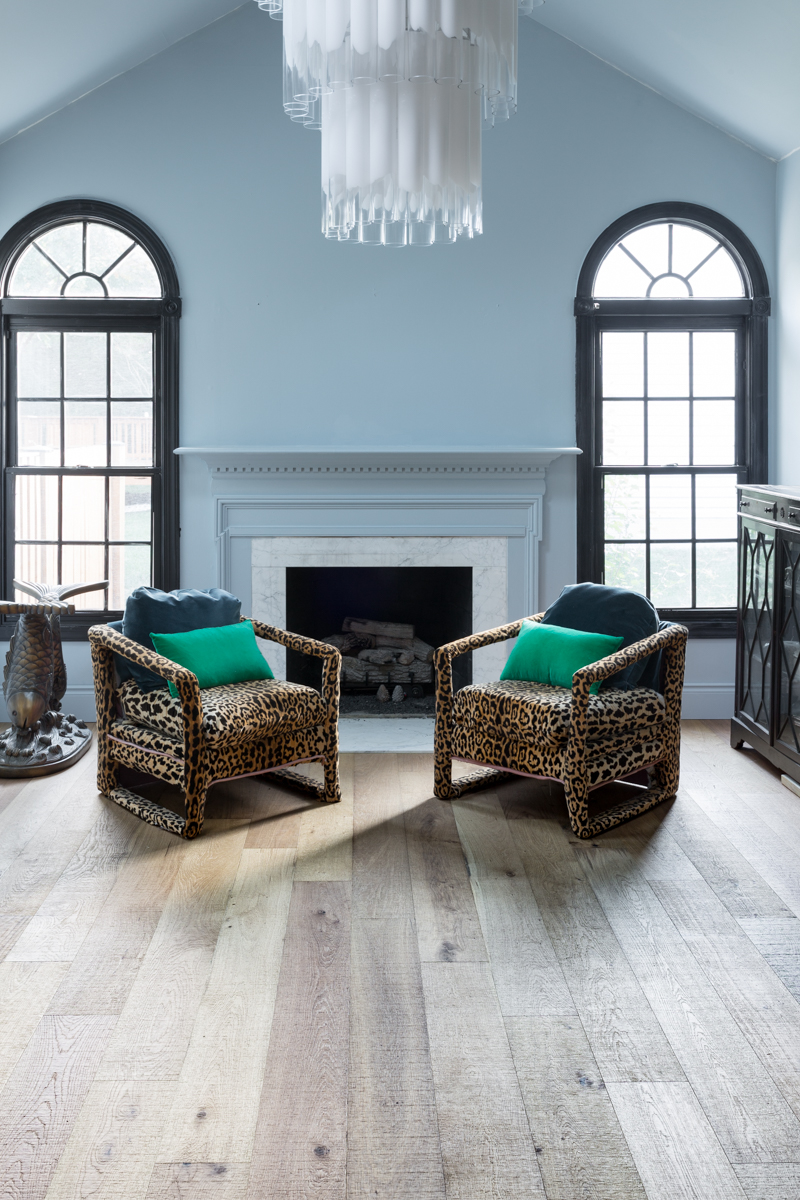 leopard chairs on lifecor flooring, Anton Fresh Aire, life core engineered hardwoods, blue walls, black trim, oversized chandelier, hardwood floors