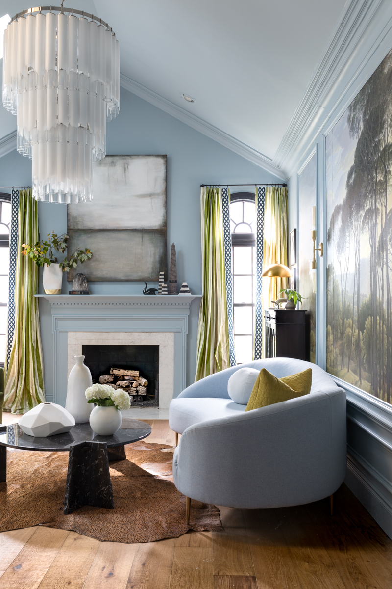 MIND BLOWING! MUST SEE THIS REVEAL! Jeweled Interiors Fall 2019 ORC, living room, scalamndre curtains, leopard rug, black marble coffee table, Rothko art, mural, and statement chandelier.