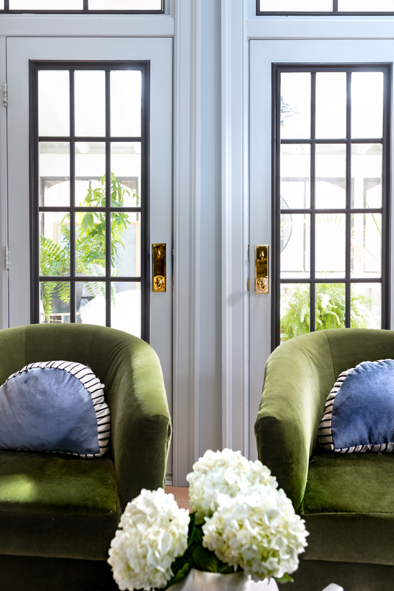MIND BLOWING! MUST SEE THIS REVEAL! Jeweled Interiors Fall 2019 ORC, living room, green velvet chairs, Emtek door knobs, unlacquered brass, blue walls, black windows