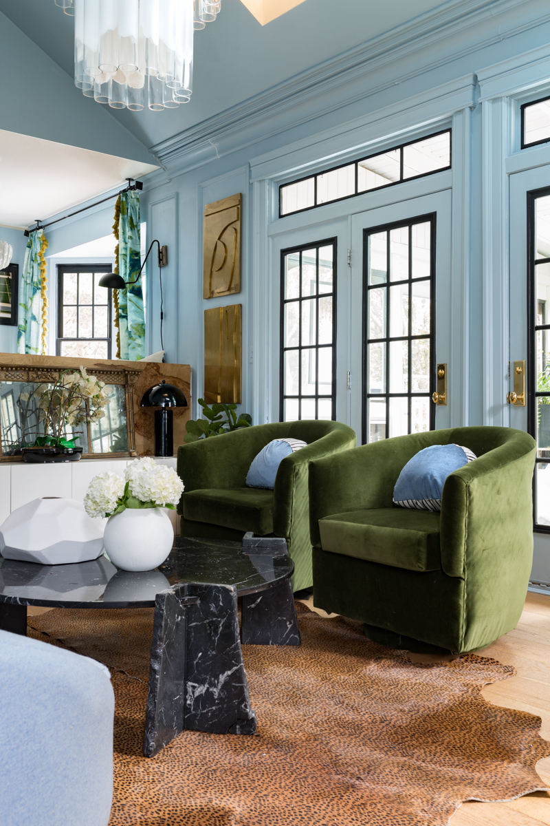 MIND BLOWING! MUST SEE THIS REVEAL! Jeweled Interiors Fall 2019 ORC, living room, lifecore flooring, Emtek handles on blue doors, leopard rug, black marble coffee table, Rothko art, mural, and statement chandelier.