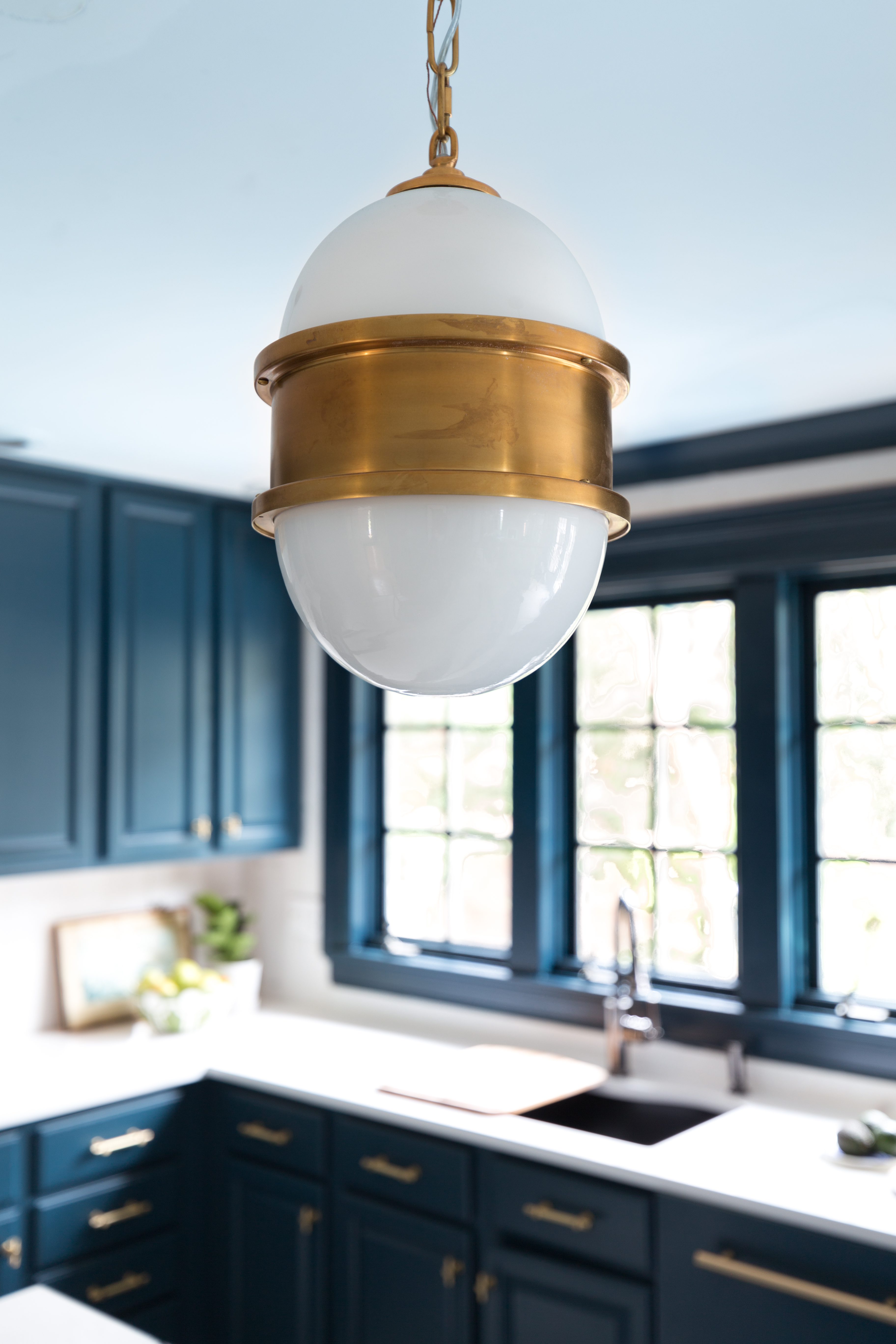 Wowzers! Check out this reveal from Jeweled Interiors Fall 2019 ORC, one room challenge. Broomley sconce, Corbett Lighting, hague blue cabinet, kitchen