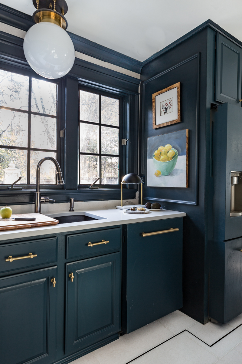 The Tile Shop San Dona marble floors with black pinstripe andhague blue cabinets for kitchen updates