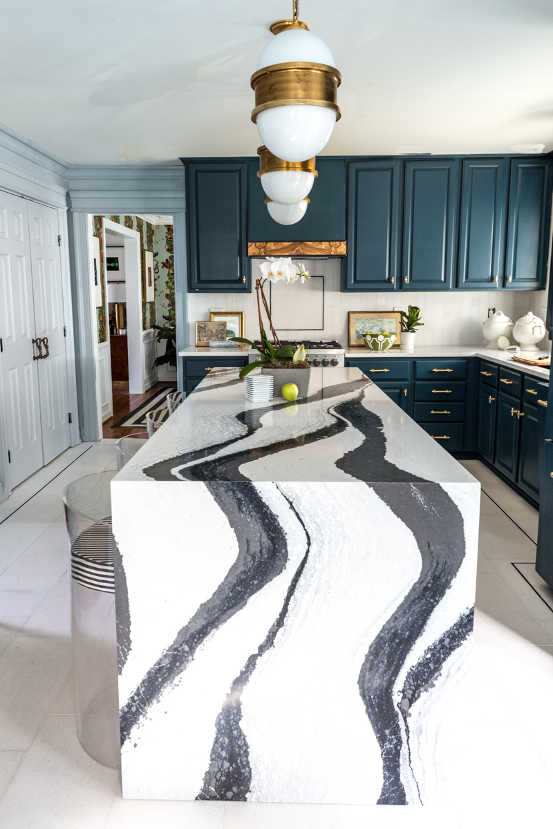 Jeweled interiors Fall 2019 ORC kitchen, Cambria Bentley island, Broomley Sconces, The tile shop marble tile, N'Hance cabinets, Schaub handles