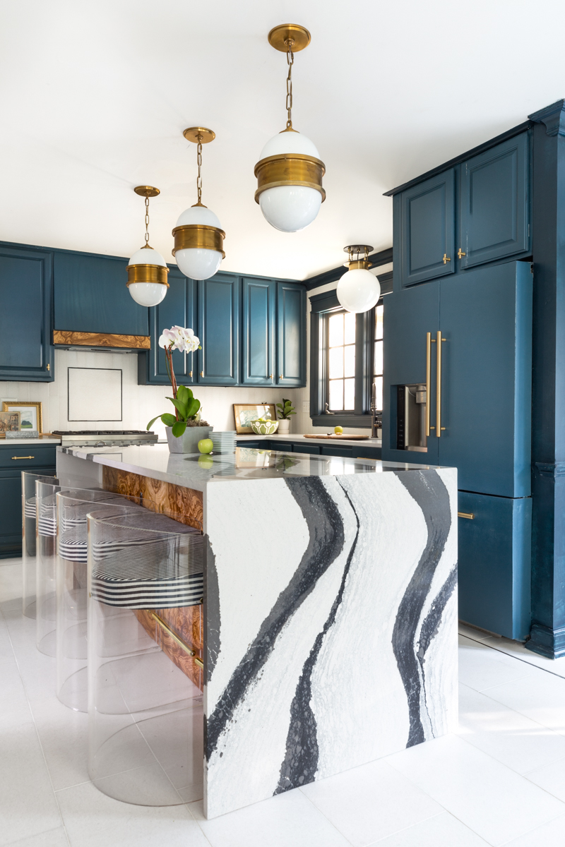 Jeweled interiors Fall 2019 ORC kitchen, Cambria Bentley island, Broomley Sconces, The tile shop marble tile, N'Hance cabinets, Schaub handles, Milton and king candy stripe chairs,