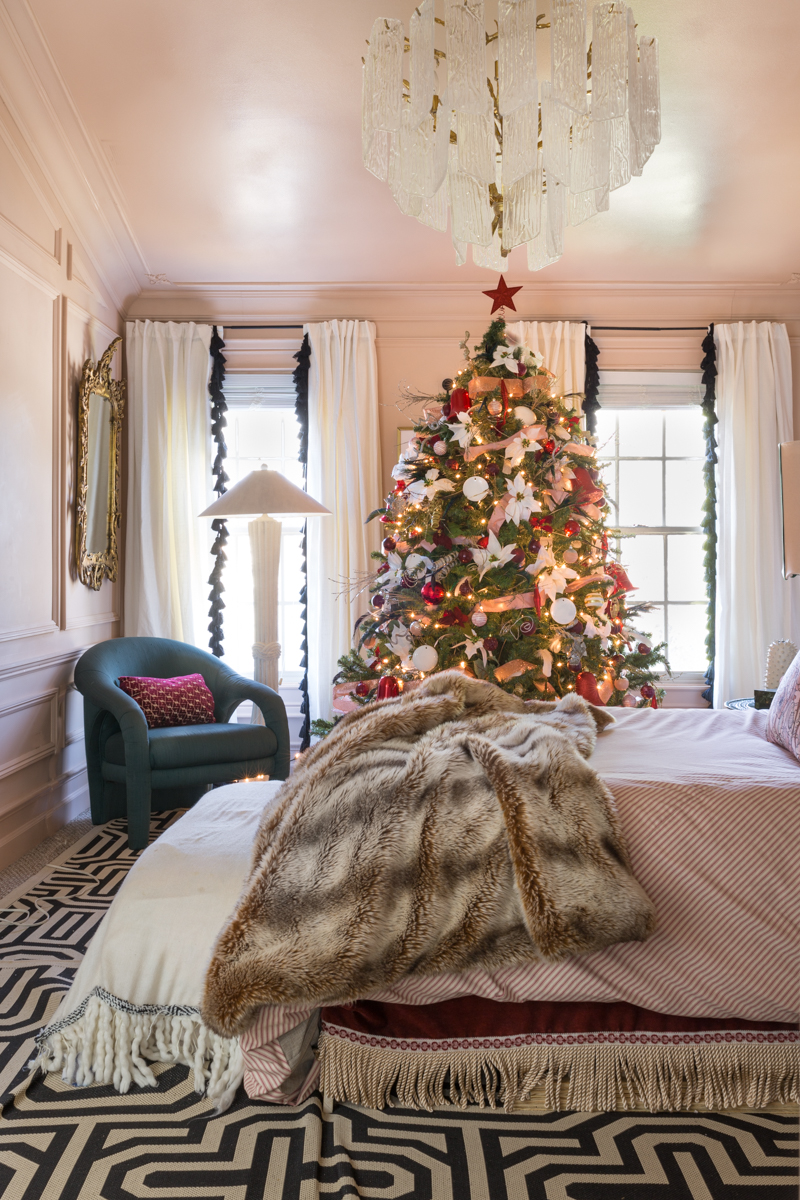 You've got to see master bedroom Christmas tree ideas in Jewel Marlowe's pink and red bedroom, embroidered sheets, crane and canopy, curious department