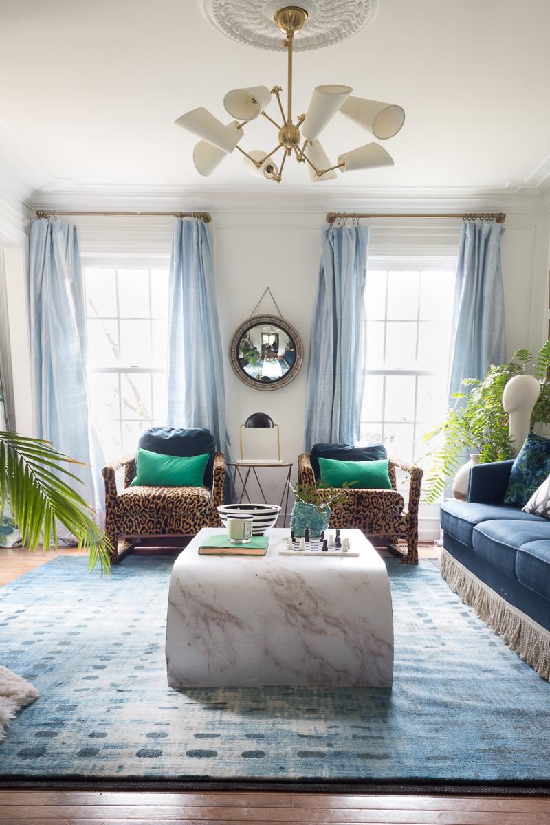Mohawk rug, leopard chairs, fringed sofa, Cassiopeia rug
