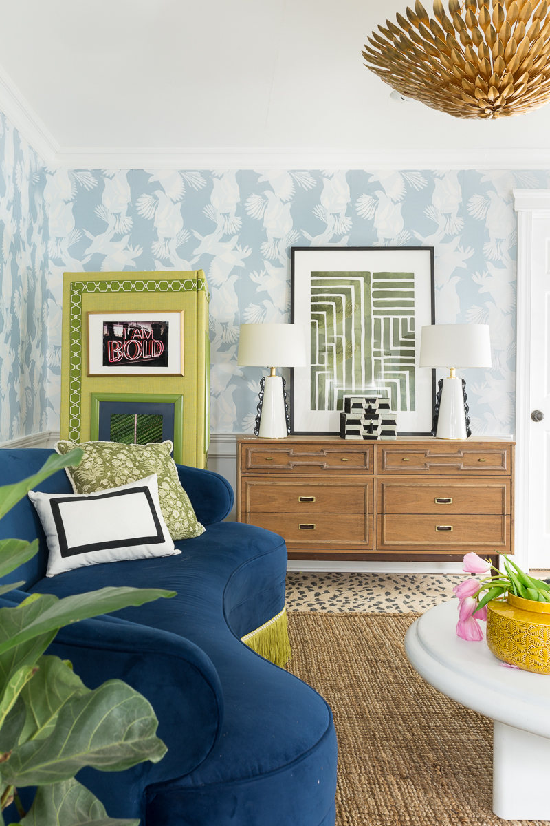 You've got to see  this s basement makeover, cassiopeia rug, mohawk, Broche chandelier, faith lamps, leopard rug, fringed sofa, blue and green room, select surfaces heritage oak.
