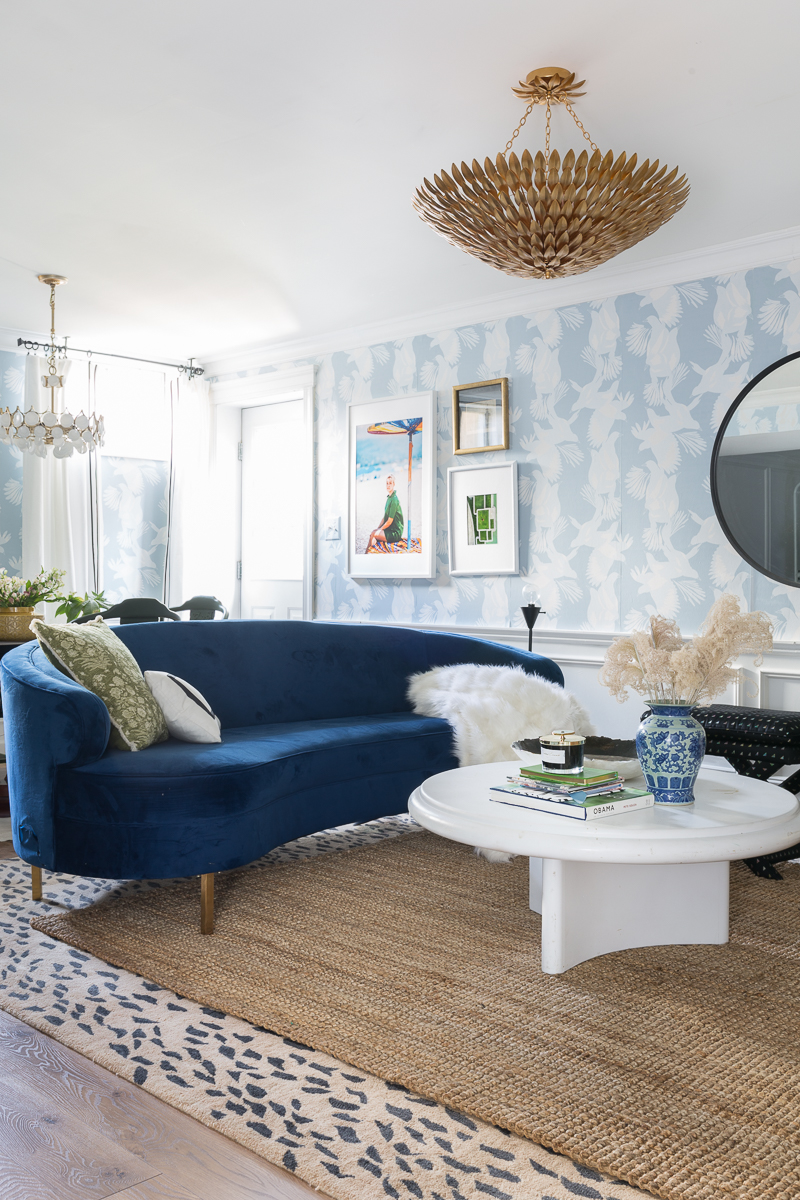 You have to see the Jewel Marlowe home tour! Jeweled Interiors, basement, summer 2020, colorful home, leopard rug, blue wallpaper, blue sofa, brooch chandelier