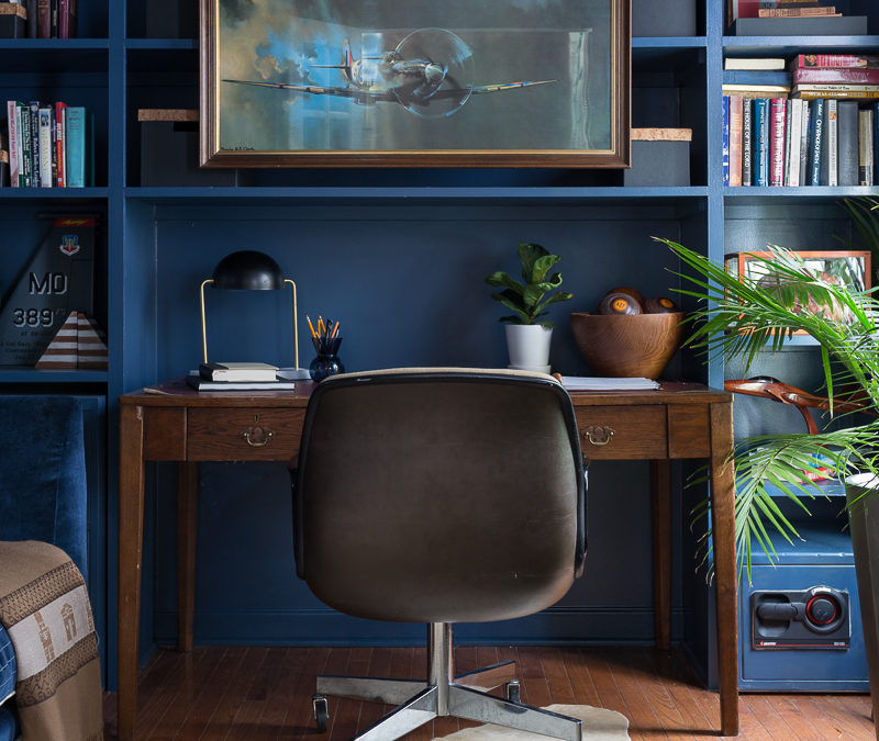 CHECK OUT this office reveal! Stiffkey blue, spoonflower, farrow and ball, Werner, Hudson valley lighting, hvlg, fringed sofa, airplane art, navy blue office, pilot's office, masculine office, navy blue office, antique desk, antique bookcase