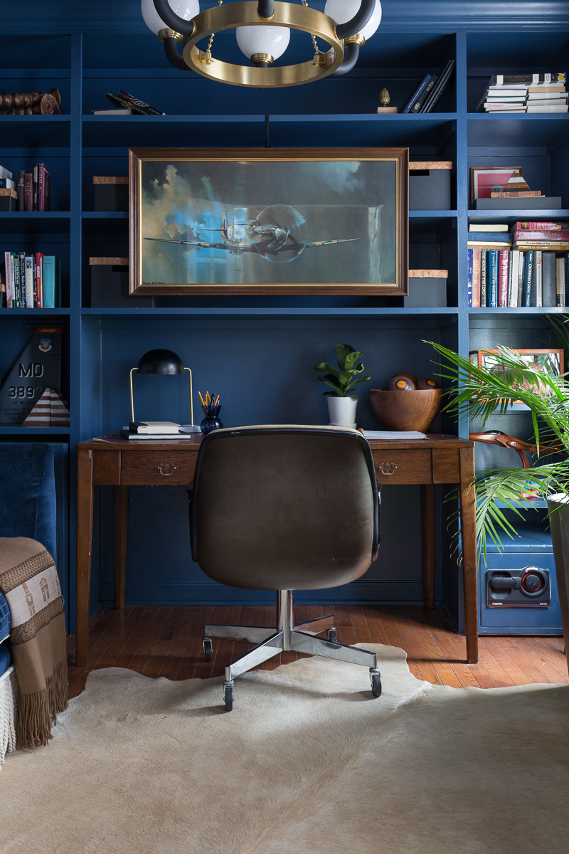 CHECK OUT this office reveal!  Stiffkey blue, spoonflower, farrow and ball, military office, Air Force office, Werner, Hudson valley lighting, hvlg, fringed sofa, airplane art, navy blue office, pilot's office, masculine office, navy blue office, antique desk, antique bookcase