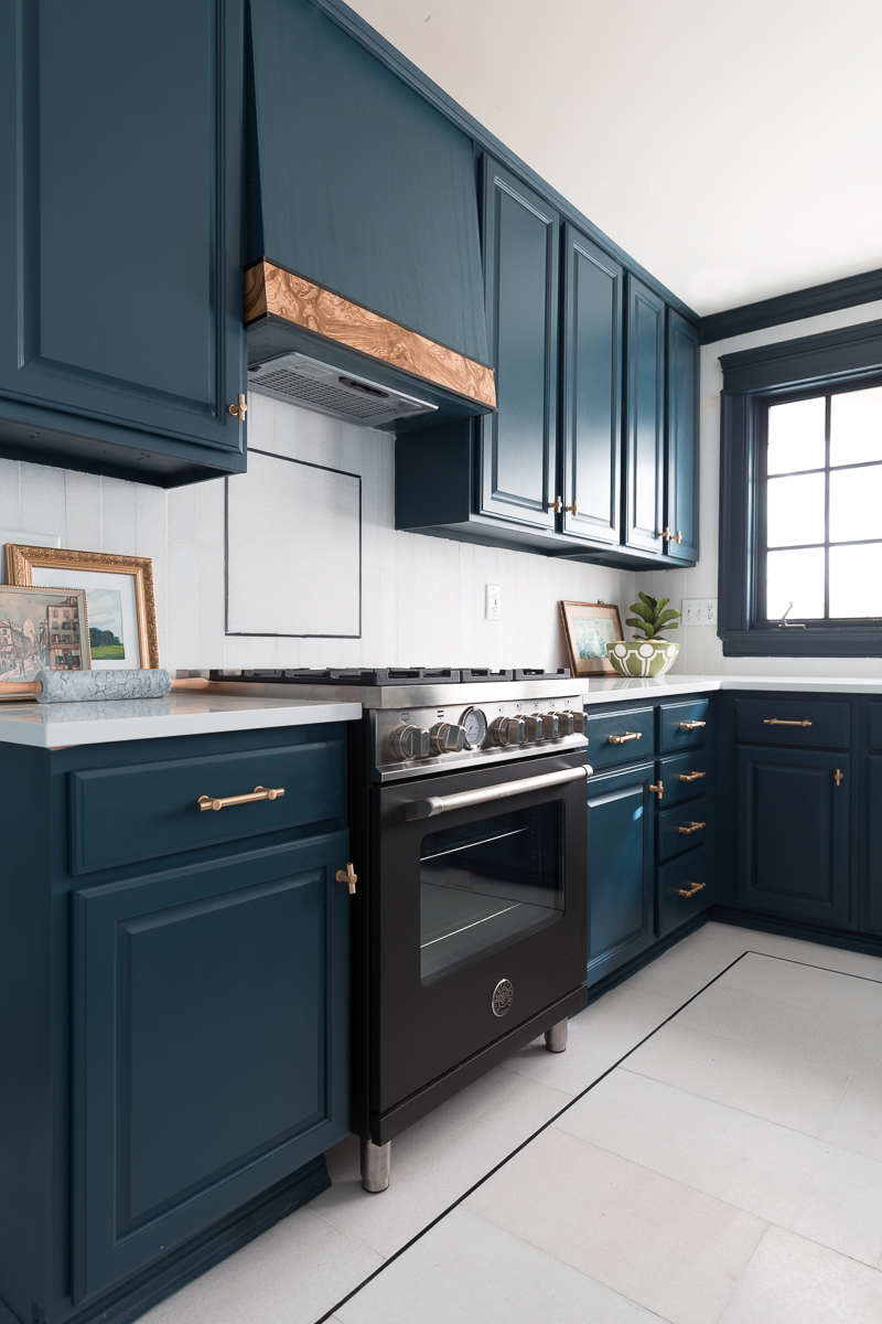 Jewel Marlowe Home Tour, Spring 2020, Jeweled Interiors kitchen, bertazzoni, burl hood vent, tile shop floors, Hague blue cabinets, Cambria countertops, Broomley sconce, Tyrell chandelier, bet