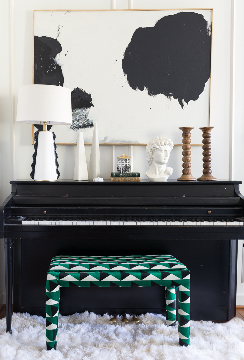 You have to see the Jewel Marlowe home tour! black and white art, piano, geometric, upholstered piano bench, sheepskin rug