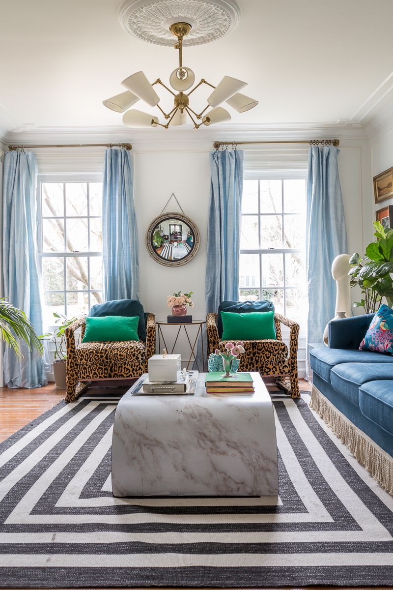 You have to see the Jewel Marlowe home tour! Leopard chairs, striped rug, silk curtains, marble coffee table, Amanda West Songbird Velvet cushion