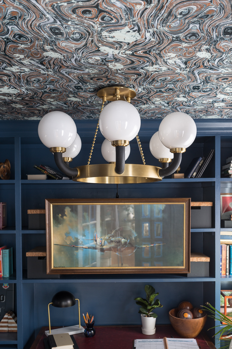 CHECK OUT this office reveal!  Stiffkey blue, spoonflower, farrow and ball, Werner, Hudson valley lighting, hvlg,  navy blue office, pilot's office, masculine office, navy blue office, antique desk, antique bookcase