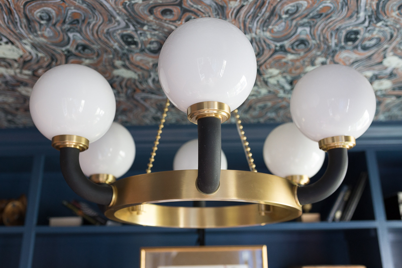 CHECK OUT this office reveal!  Werner chandelier, Stiffkey blue, spoonflower, farrow and ball, Werner, Hudson valley lighting, hvlg, airplane art, navy blue office, pilot's office, masculine office, navy blue office, antique desk, antique bookcase