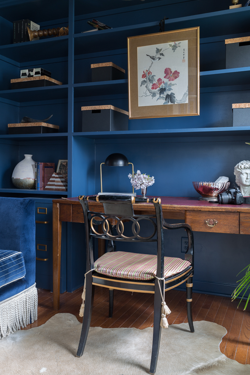 Jeweled Interiors Stiffkey Blue, Farrow and Ball, office, with built in shelves, and organization boxes, and antique desk and chair, wallpapered ceiling