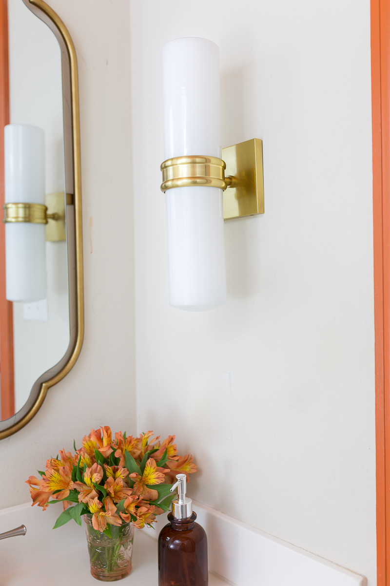 bathroom lighting, Natalie sconce, inexpensive lighting, Mitzi lighting, wall sconce, Anthropologie mirror, orange trim