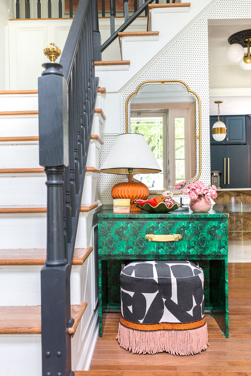 colorful home, Jewel Marlowe Home Tour, summer 2020, jeweled interiors portfolio, entryway, malachite table, black and white ottoman, fringe, orange, pink