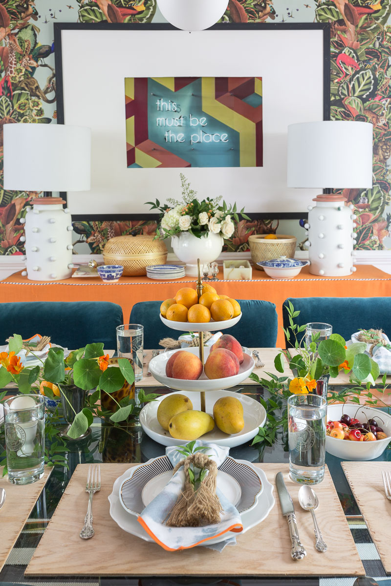 colorful home, Jewel Marlowe Home Tour, summer 2020, jeweled interiors portfolio, dining room, jungle wallpaper, orange buffet skirt, fruit centerpiece, smithhonig