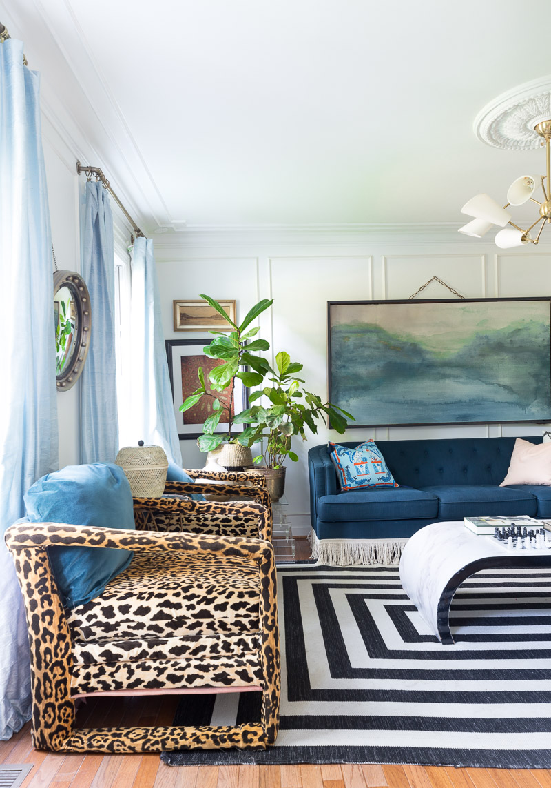 colorful home, Jewel Marlowe Home Tour, summer 2020, jeweled interiors portfolio, living room, black and white striped rug, leopard chairs, moulding, navy sofa