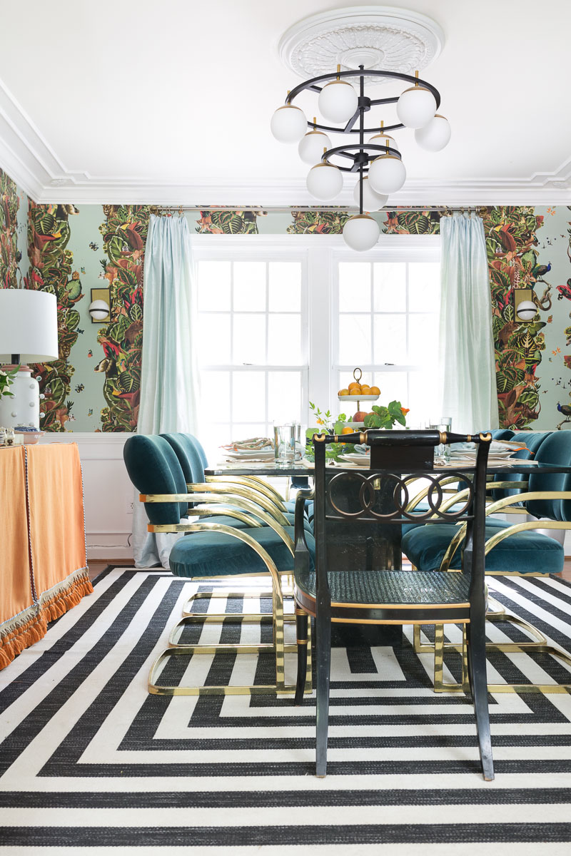 colorful home, Jewel Marlowe Home Tour, summer 2020, jeweled interiors portfolio, dining room, jungle wallpaper, black and white striped rug, orange buffet skirt