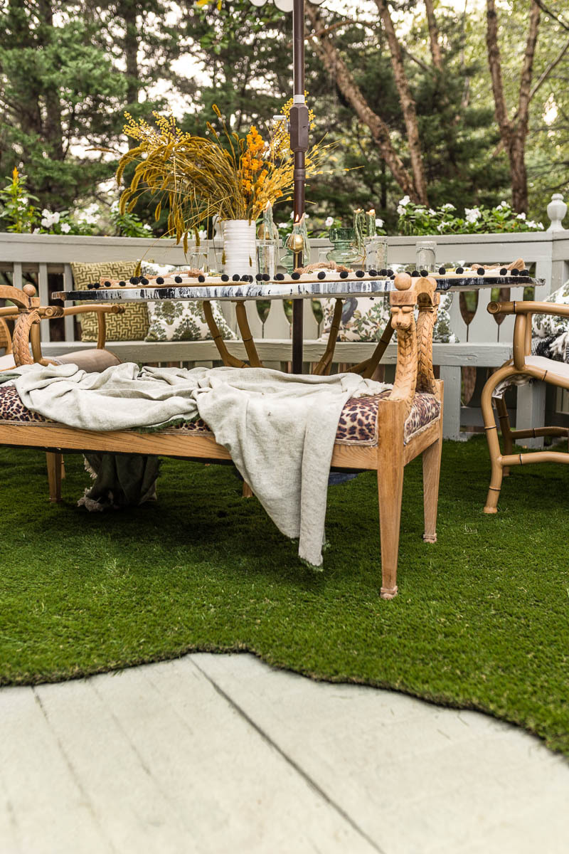 patio decorating ideas, patio ideas, grass rug, antique bench, agate table, deck, entertaining, fall, Anthropologie