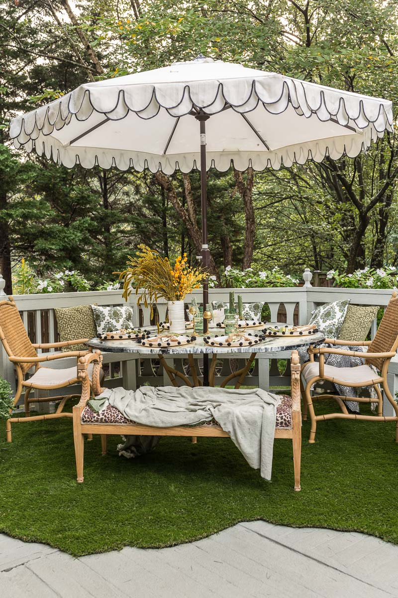 REVEAL! patio decorating ideas, patio ideas, Rustoleum RockSolid, deck resurfacer, artificial grass rug,  Candace Heil, agate table, sailrite, Phiftertex, patio chairs, safaviah, patio umbrella